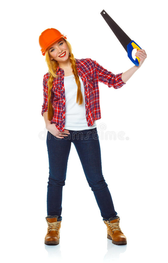 Young woman in helmet with a saw on a white background royalty free stock photos