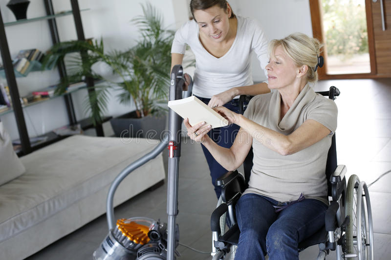 Young woman helping disabled lady stock photos
