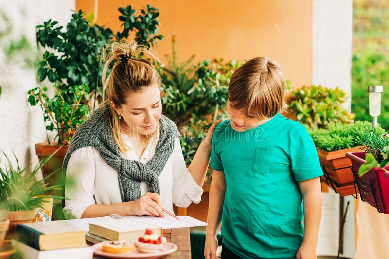 Young woman helping little boy royalty free stock photography