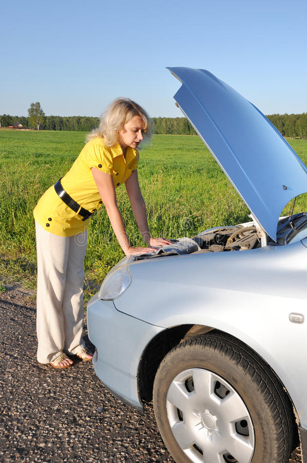 Download Young Woman In Her Car Breaks Down. Engine Failure Stock Photo - Image: 14966332