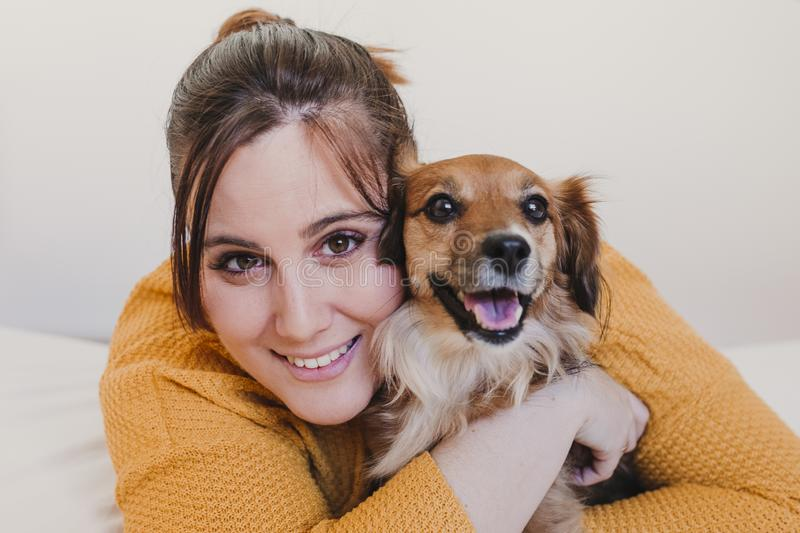 Young woman and her cute dog sitting on bed. love for animals concept. top view. Young woman and her cute dog sitting on bed. love for animals concept. Hug stock photo