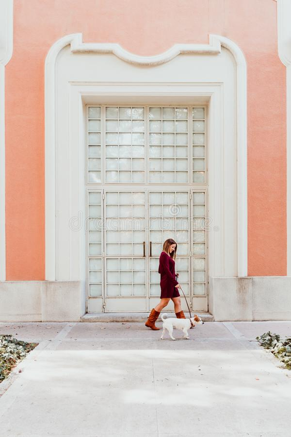 young woman and her cute jack russell dog walking by the city. Love for animals concept royalty free stock image