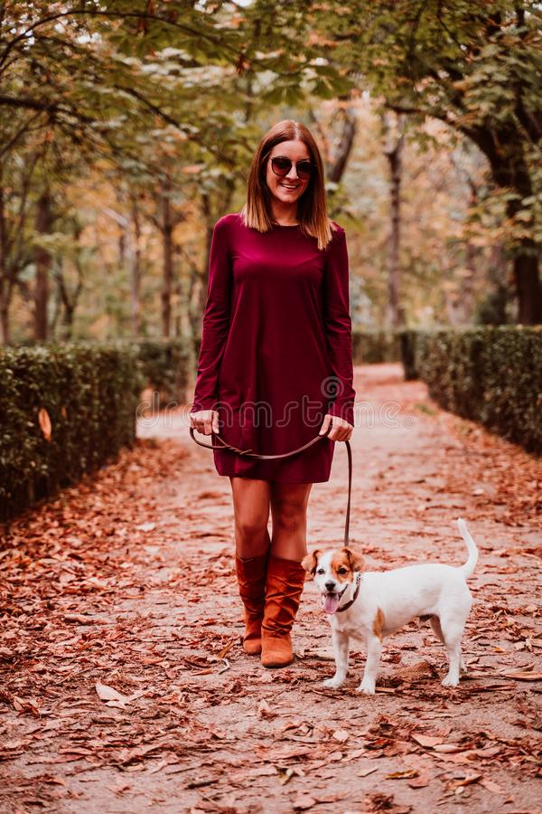 young woman and her cute jack russell dog walking in a park. Love for animals concept royalty free stock photo