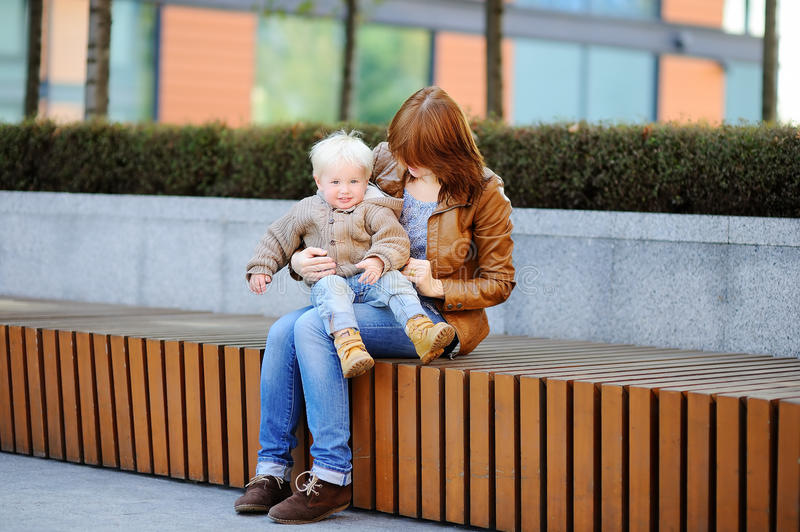 Young woman and her cute toddler son stock image