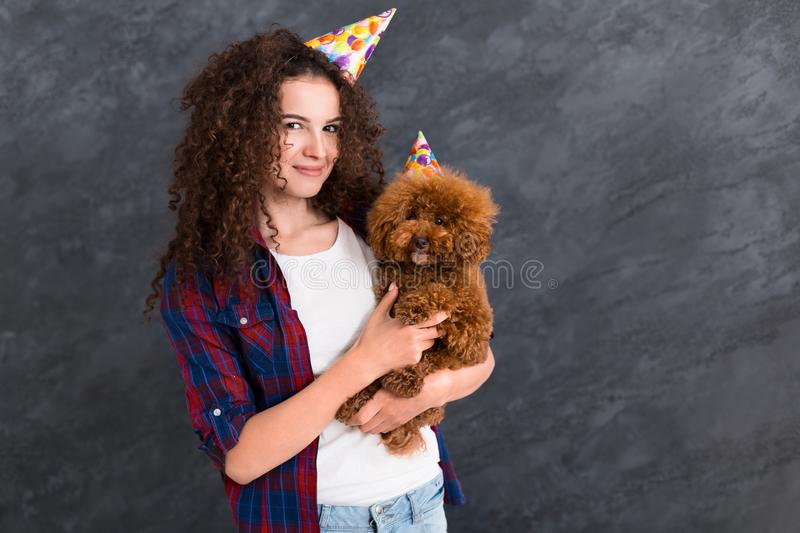 Young woman and her dog celebrate birthday stock photography