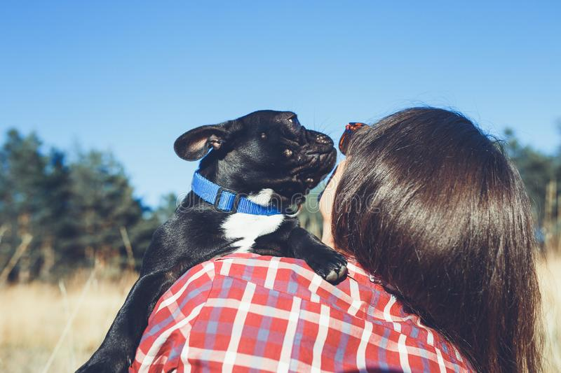 Young woman with her dog outdoors stock photo