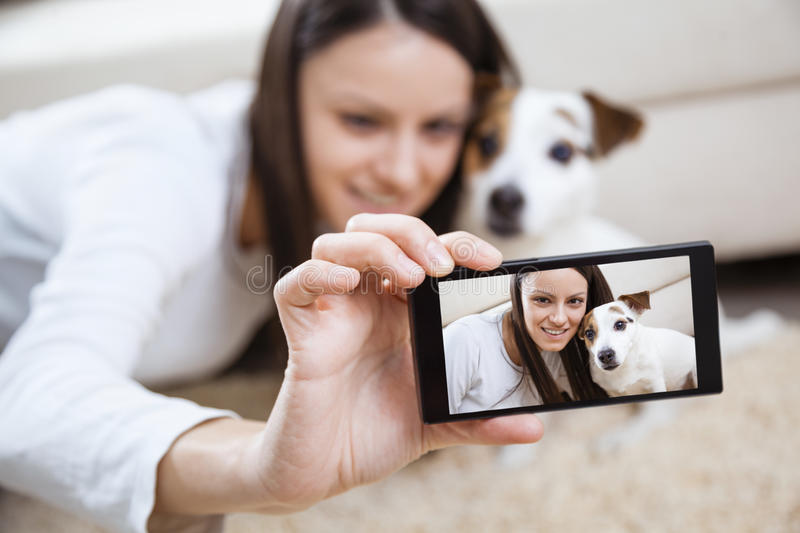 Young woman with her dog stock photo