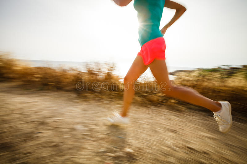 Young woman on her evening jog. Along the seacoast royalty free stock photo