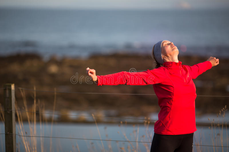 Young woman on her evening jog. Along the seacoast stock images