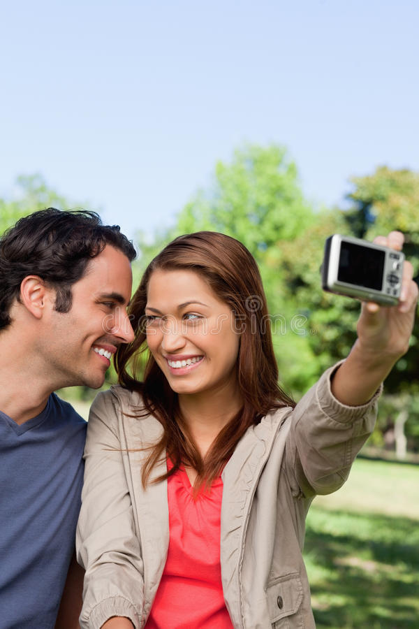 Download Young Woman And Her Friend Look At Each Other While She Takes A Stock Photo - Image: 25332082