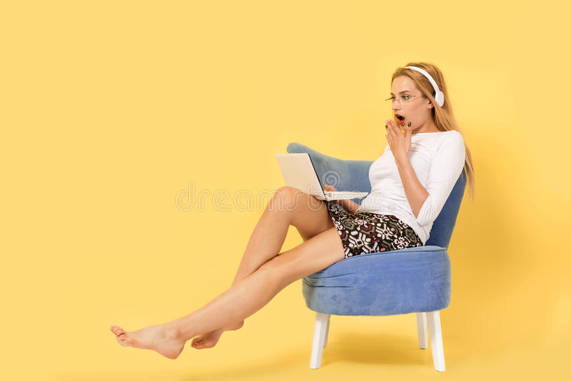 Young woman with her laptop pc is shocked stock images
