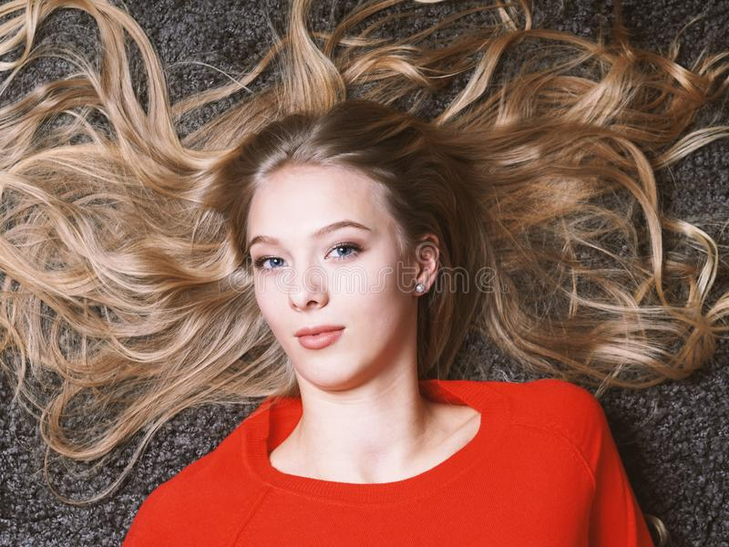 Young woman with her long blond hair spread out stock images