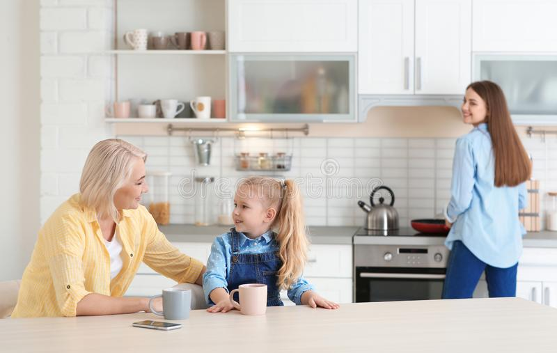 Young woman, her mother and daughter spending time stock photo
