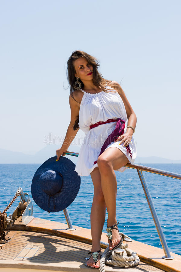 Young woman on her private yacht royalty free stock photos