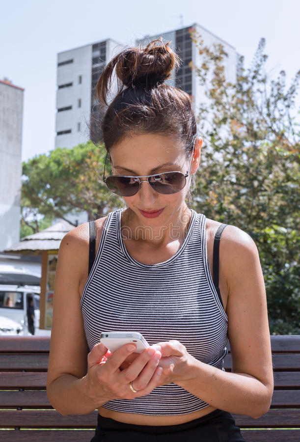 Young woman and her smartphone. royalty free stock photos