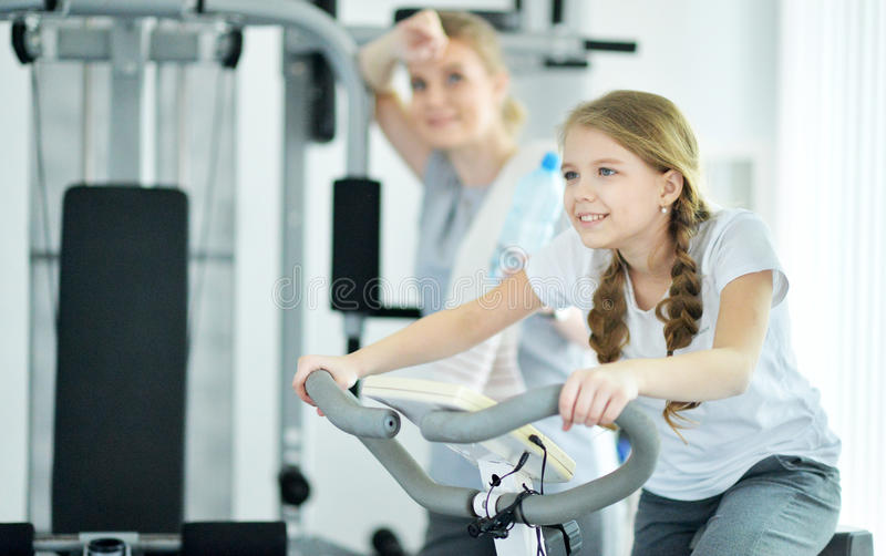 Young woman with her teenage daughter in a gym stock images