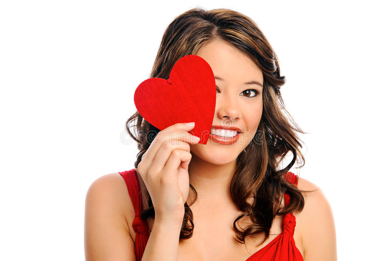 Young woman hides behind heart royalty free stock photo