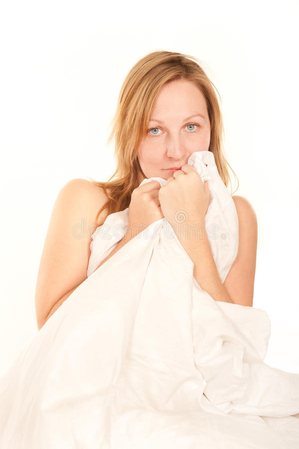 Young Woman Hiding Behind Bedclothes Stock Images