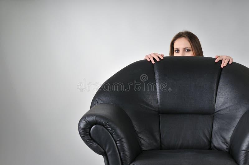 Young Woman Hiding Behind Big Stock Photo