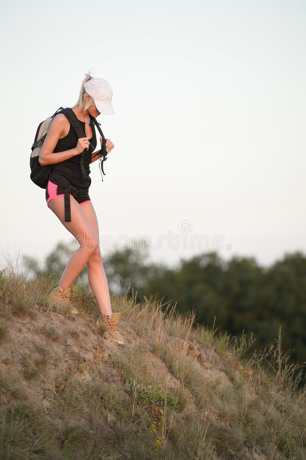 Young woman hiker hiking in spring forest trail stock photo