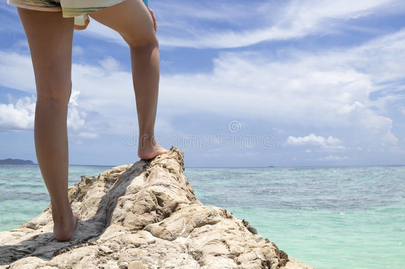 Young woman hiker legs on seaside mountain stock photos