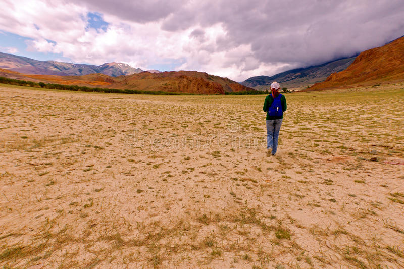 Young woman hiking Altai royalty free stock image