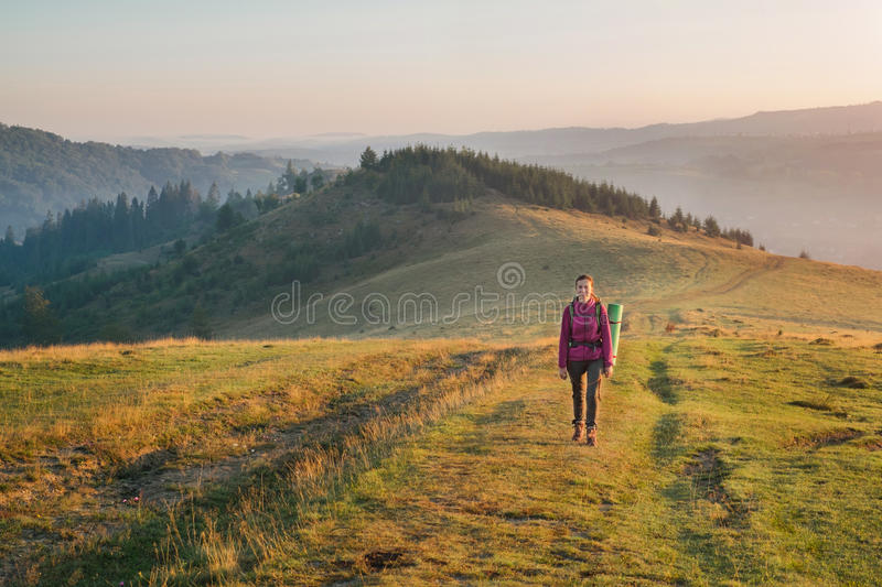 Download Young Woman Hiking With Backpack In The Mountain Stock Image - Image: 83705263