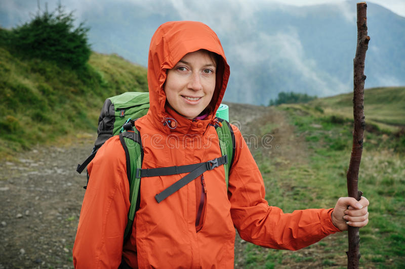 Download Young Woman Hiking With Backpack In The Mountain Stock Image - Image: 83704239