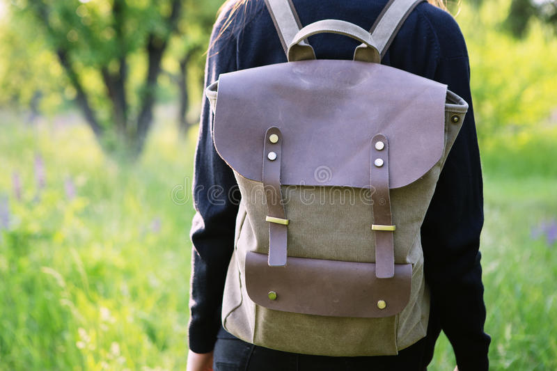 Young woman hiking with backpack stock image