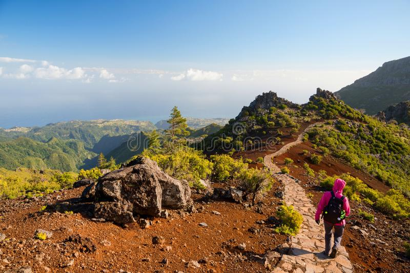Young woman hiking on path to Pico Ruivo, highest peak of Madeira island, Portugal. Young woman hiking on path to Pico Ruivo, highest peak of Madeira, Portugal stock photos