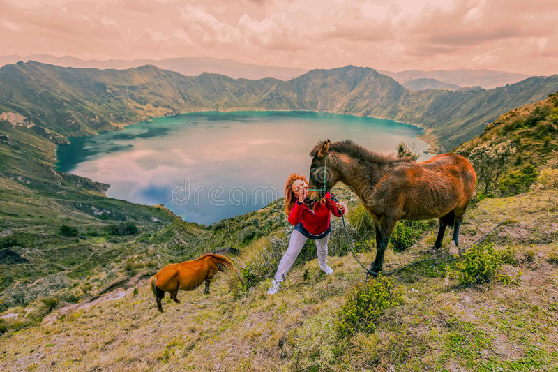 Young Woman Hiking With Two Horses royalty free stock image