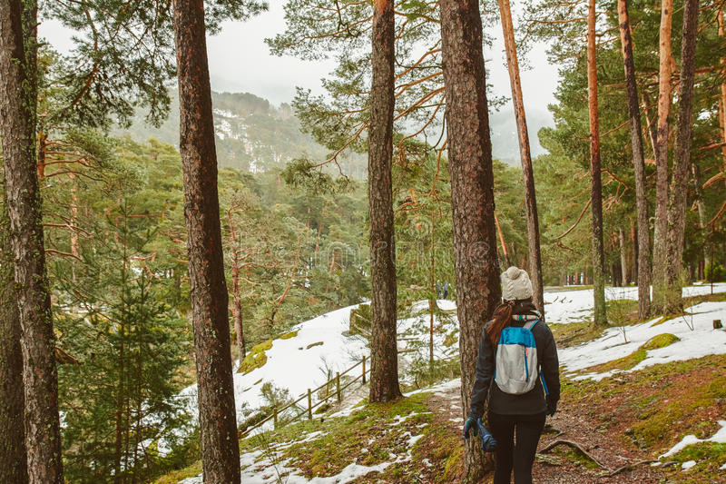 Young woman hiking in white winter forest. Lifestyle concept. royalty free stock photo