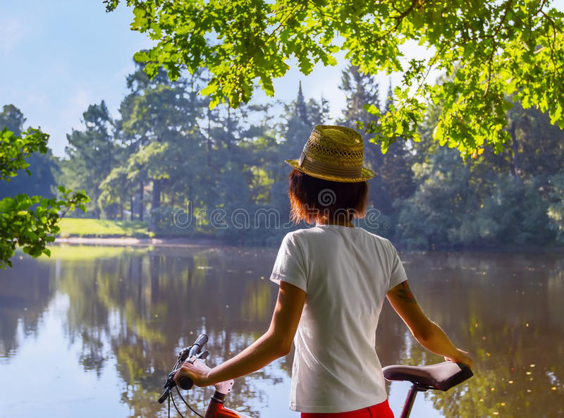 Young woman Hipster with bike stock images