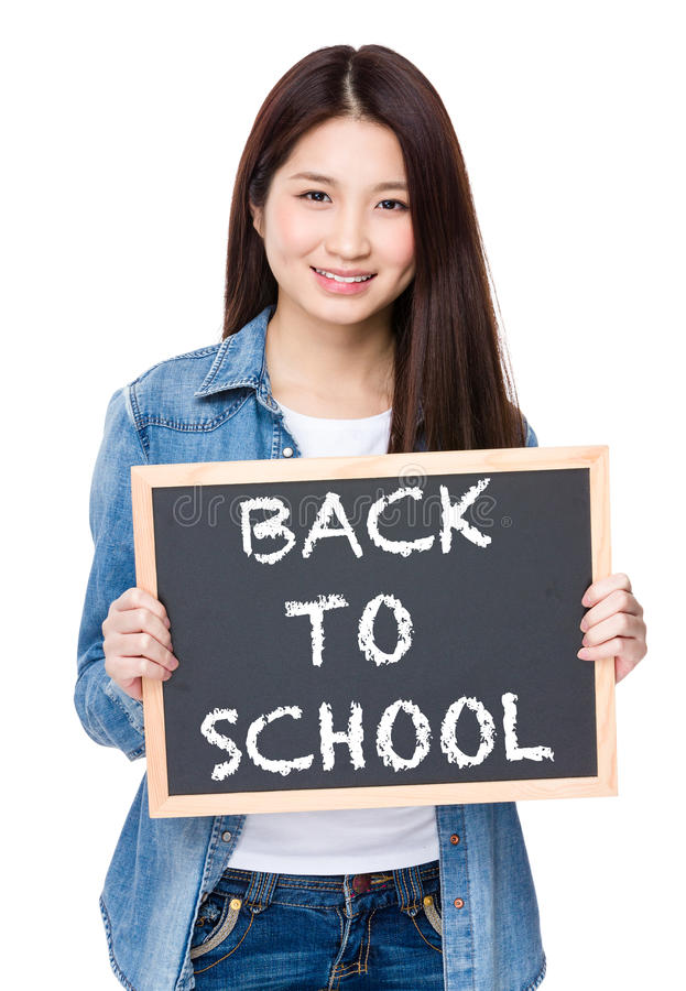Young woman hold with chalkboard showing phrase of back to schoo royalty free stock images