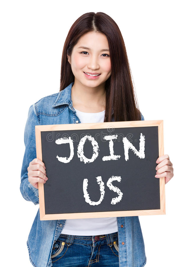 Young woman hold with chalkboard showing phrase of join us royalty free stock images