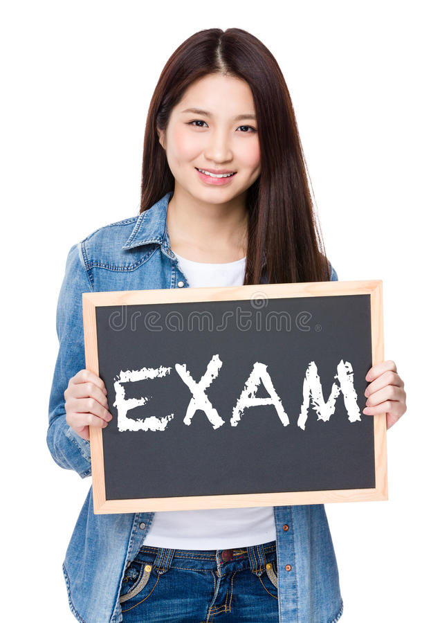 Young woman hold with chalkboard showing a word exam stock image