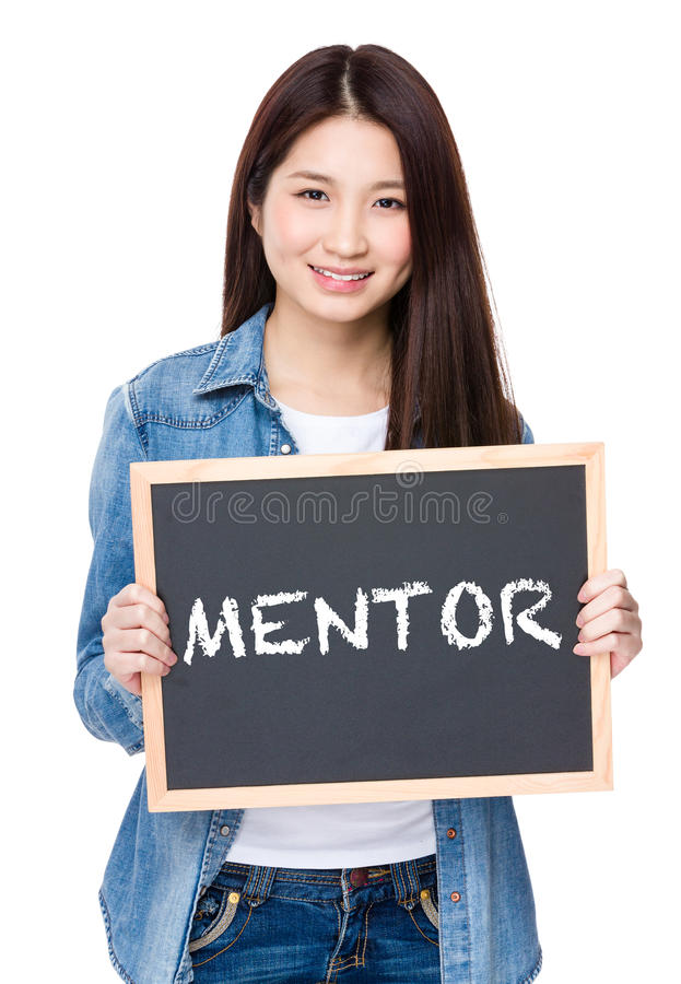Young woman hold with chalkboard showing a word of mentor royalty free stock photography
