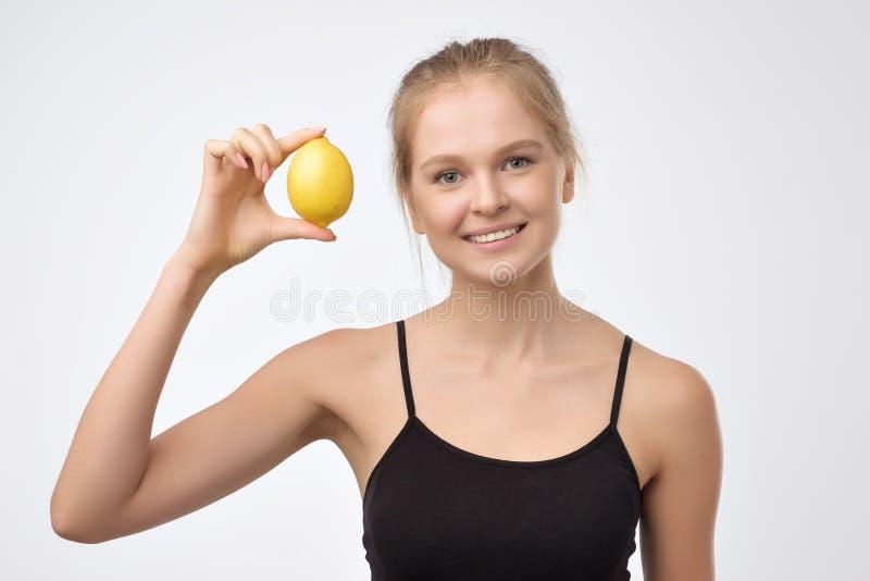 Young woman hold lemon, citrus fruit. stock photography
