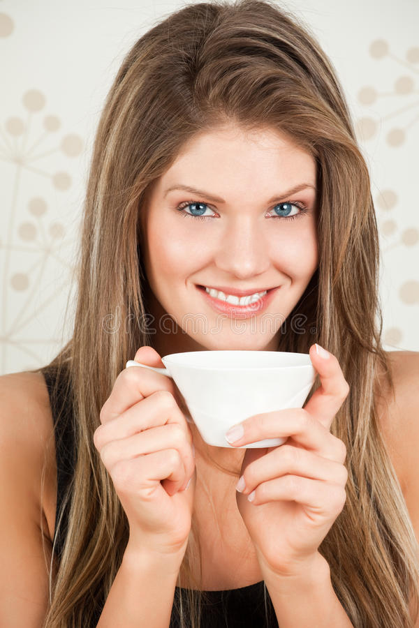 Free Young Woman Holding A Cup Of Tea And Smiling Stock Photo - 17708130