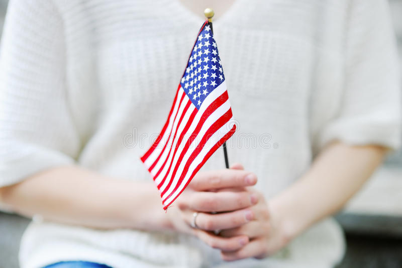 Young woman holding american flag close up stock image