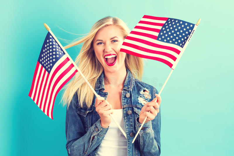 Young woman holding American flag royalty free stock photography