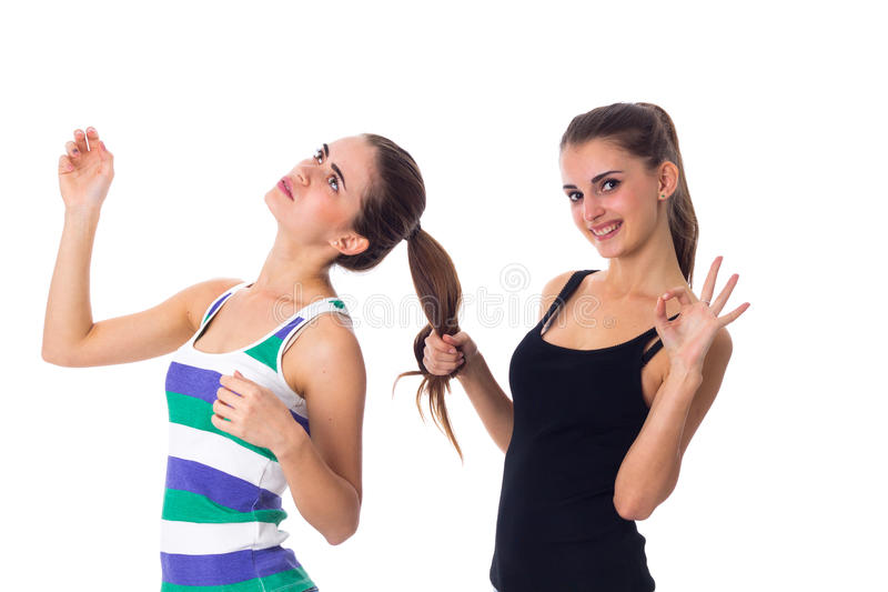 Young woman holding another woman's hair royalty free stock image