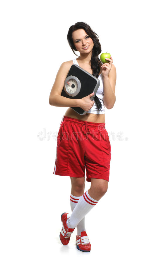 A Young Woman Holding An Apple And Scales Royalty Free Stock Photography