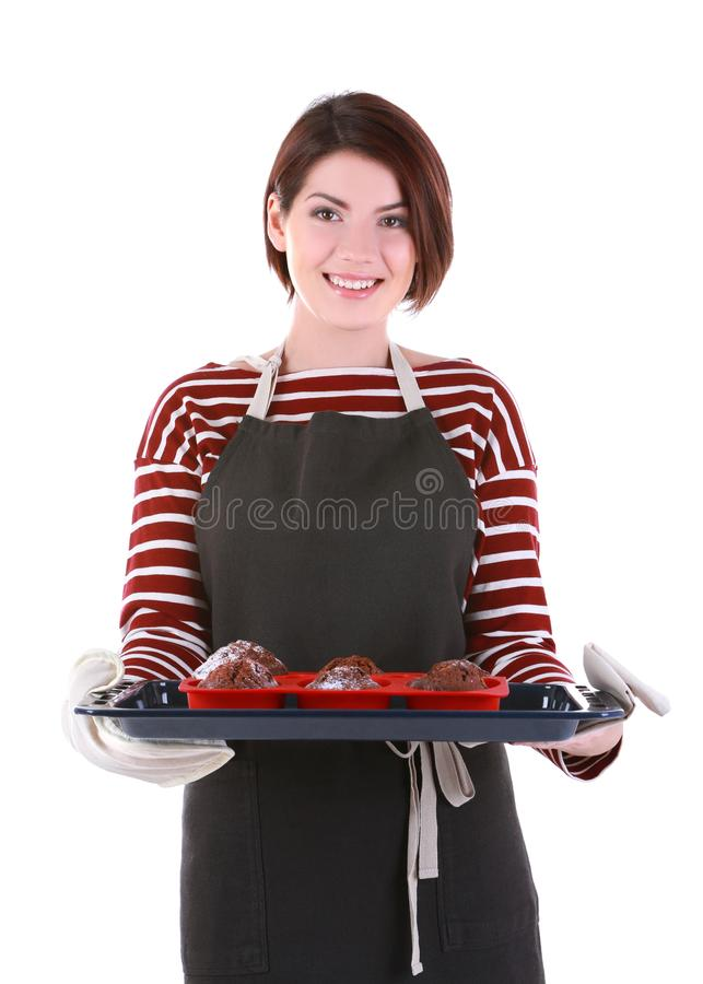 Young woman holding baking tray with delicious chocolate stock photo