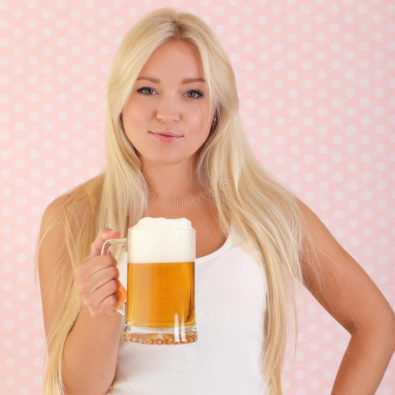 Young woman holding a beer royalty free stock images