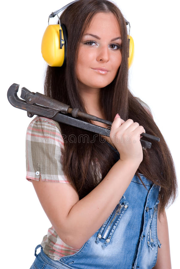 Download Young Woman Holding Big Wrench Stock Photo - Image of headphones, background: 11567236