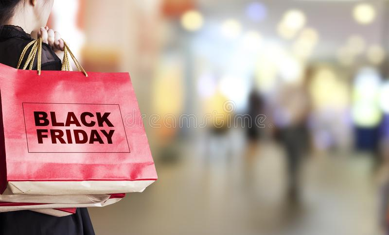 Download Young Woman Holding Black Friday Shopping Bag Stock Photo - Image of human, fashion: 101222938