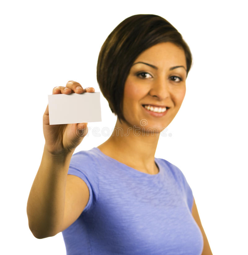 Young woman holding a blank business card stock image