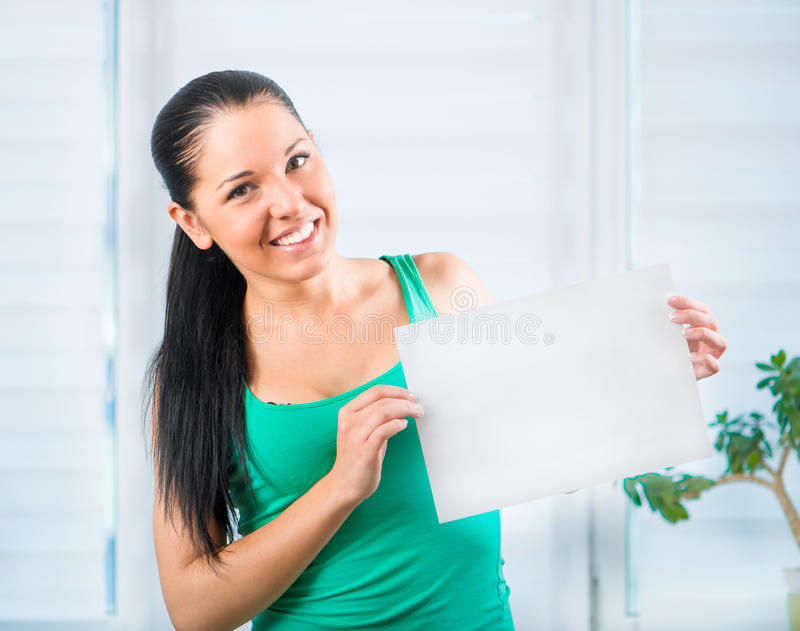 Young woman holding a blank royalty free stock image
