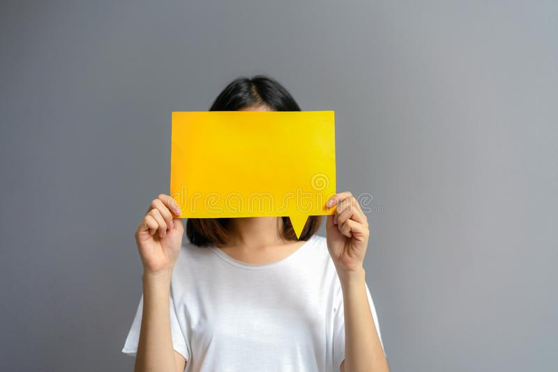 Young woman holding a blank poster for text on a white background stock photos